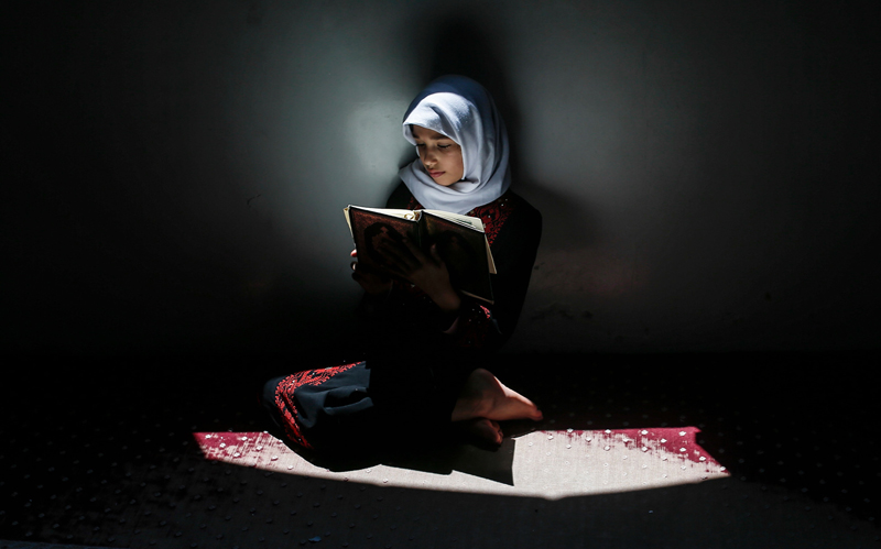 Gaza City: A Palestinian girl attends a Koran memorization class while respecting social distancing due to the COVID-19 pandemic, at a mosque in Gaza City, on June 29, 2020. AFP PHOTO