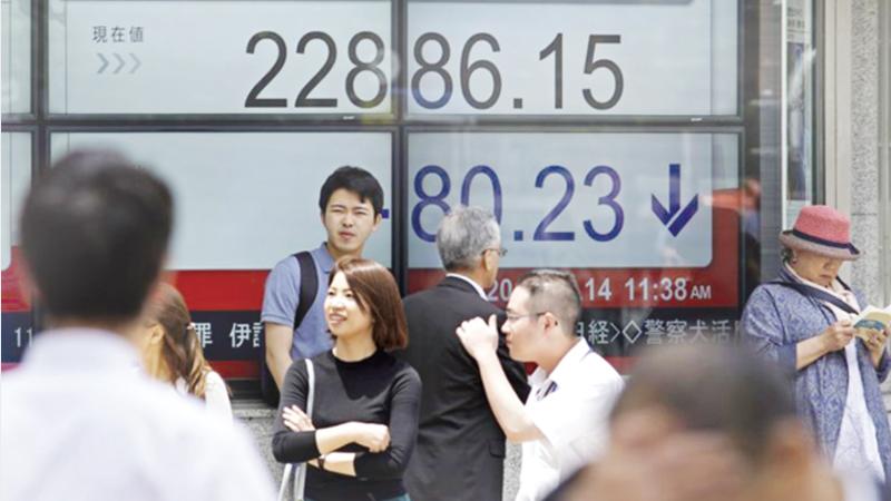 Asian markets lower after hawkish Fed, fresh trade war fears