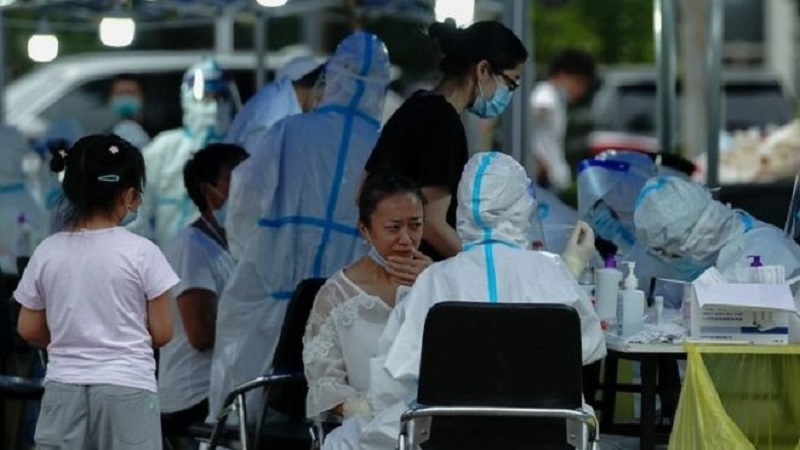 China locks down 400,000 people after virus spike