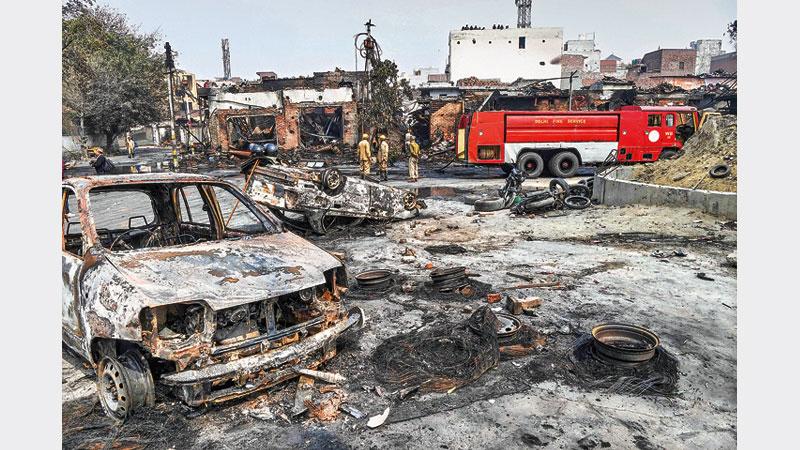 Death toll hits 27 as Modi calls for calm