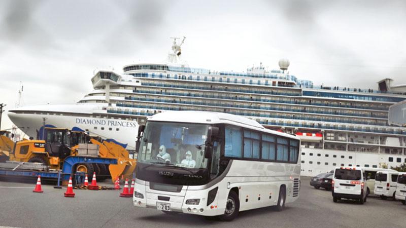 Japan lets some passengers leave ship for quarantine on land