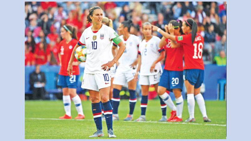 Lloyd propels USA into World Cup last 16