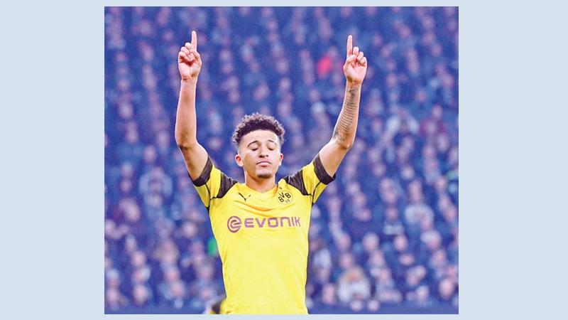 Sancho shoots Dortmund nine points clear