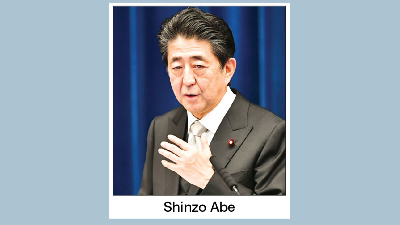 Abe shakes up cabinet, brings in rising star