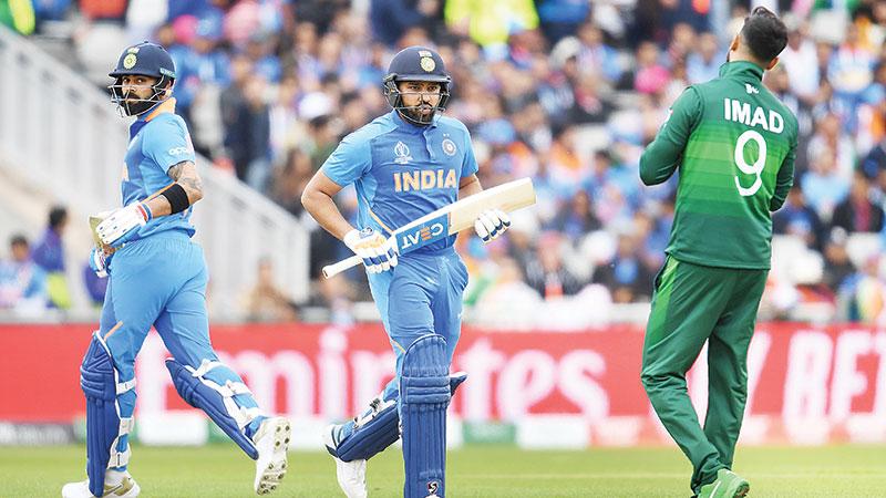 Ton-up Sharma puts India on top against Pakistan