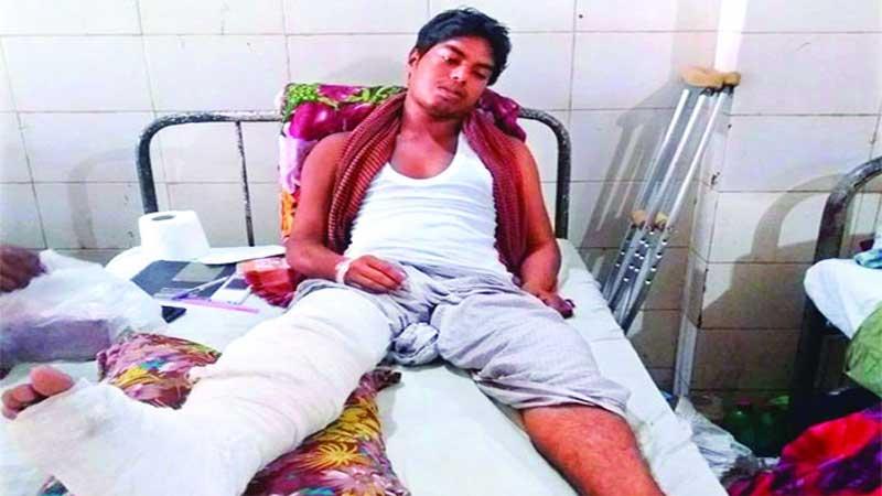 Injured Tariqul being brought to Dhaka
