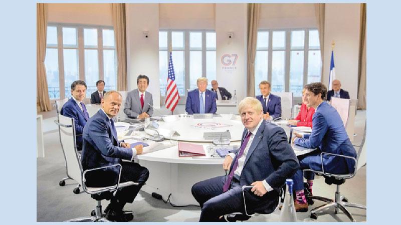 Trump backs 'right man' Johnson at fractious G7 summit