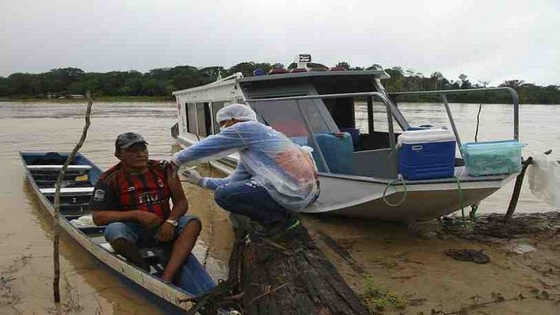 Boat, snowmobile, camel: Vaccine reaches world's far corner