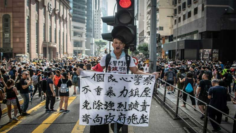 Tens of thousands march again in huge Hong Kong anti-government rally