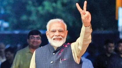 Whose path is Modi following?