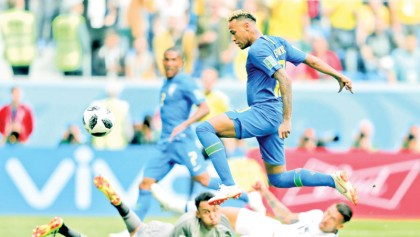 Brazil edge towards last 16