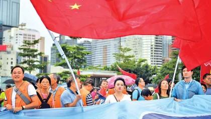 Rivals rally as Hong Kong's divisions deepen