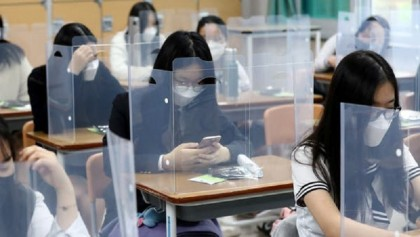 South Korea limits school numbers over virus spike