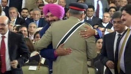 Sidhu under fire from BJP for hugging Pakistan army chief
