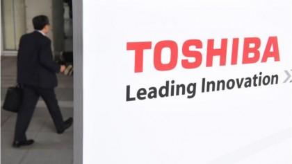 Toshiba shares fall on new share sale plan