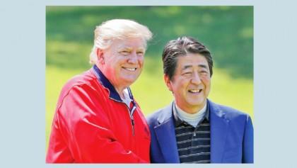 Trump downplays North Korea missile launches on Japan visit
