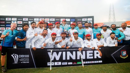 Rashid bowls AFG to historic win