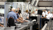 Airport security trays carry more germs than toilets: Study