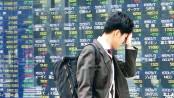 Asian shares drop on trade talks fears, weak US retail