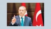 Erdogan threatens to destroy new US-backed border force