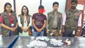 Man held with foreign currencies