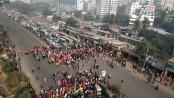 RMG workers block road demanding salary hike