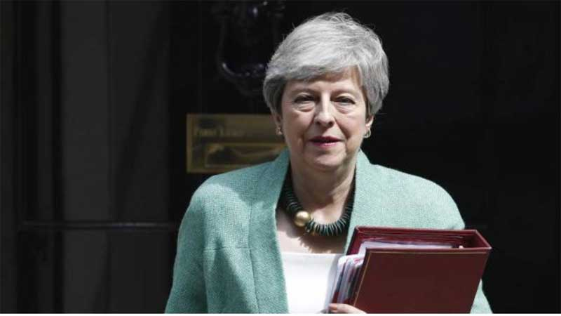 UK PM May takes swipe at front-runner Boris Johnson