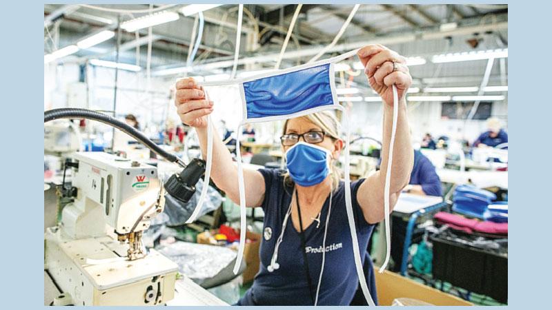 N Ireland sportswear factory scrubs up in virus fight